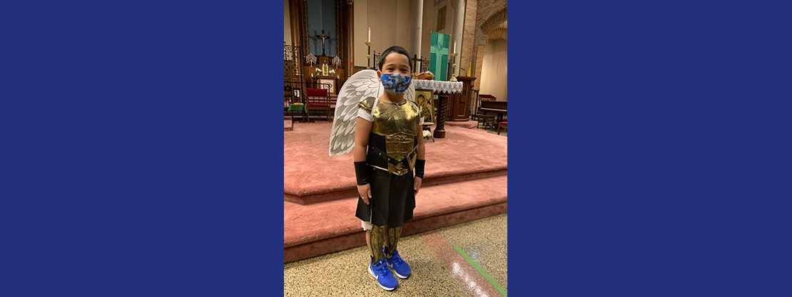 student in angel costume in church